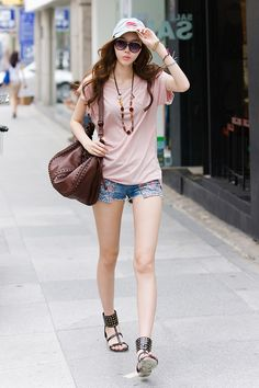 Pink top, customized denim short, cap, and sandals