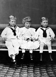 Prince Edward (later Edward VIII then Duke of Windsor), Princess Mary, and Prince Albert (later King George VI).