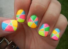 If you really like colorful nails for your short nails then this will definitely be something you adore. Each nail has a different design and uses about 6 different very bright colors to create this awesome effect. These are the type of nails that would be really awesome in spring time.