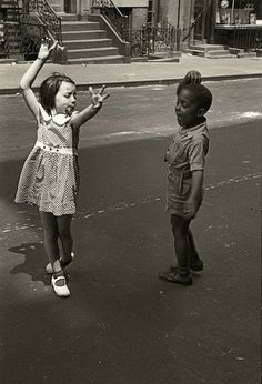 """New York, circa 1940 kids dancing"", photograph by Helen Levitt, noted for ""street photography"" around New York City, and has been called ""the most celebrated and least known photographer of her time."""