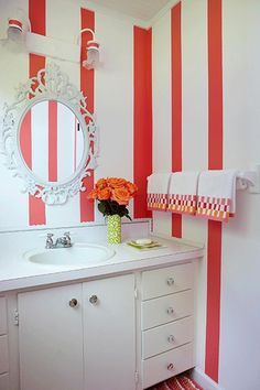 Bathroom Decor Ideas...not in these colors, but I like the stripes on the wall