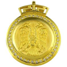 S.Georgios designer 18 Karat Yellow Gold Double-Headed Eagle Diamond Coin Pendant is all handmade and feature Brilliant cut Diamonds around the coin total weight of 0,48 Carats. On the top of the bezel, we have set the Greek Design symbol to give it a beautiful unique look and we have made the back clasp to open and close so it can be clipped on and worn on any necklace like pearls, etc. The coin (A replica -an exact copy of the original) is known as the double nature of the eagle as the… Double Headed Eagle, Greek Design, Chandelier Pendant Lights, Coin Pendant, 18k Gold, Coins, Rose Gold, Stone, Batu