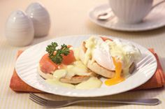 Eggs Benedict with Creamy Blue Sauce Featuring Castello® Mellow Blue Cheese #appetizer #bluecheese #recipe