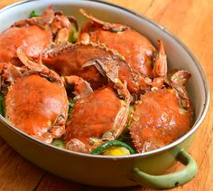 In this ginataang alimasag dish, blue crabs are first steamed and then simmered in a rich coconut sauce with calabasa and long beans