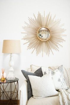 The sunburst mirror styling in gold tones warms a room with WOW style