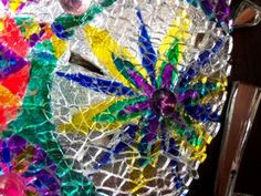Close-up of the Fireworks Kaleidoscope piece.  Great view of the reclaimed brokent tempered glass used in the work. Piece created by Deb Olander. I can be reached at DebsTreeFrogArts@gmail.com or at my Etsy shop: https://www.etsy.com/shop/TreeFrogMosaics