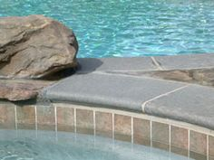 American Pool provides many choices when building a swimming pool such as pool decking, pool tile, pool plaster, pool equipment and speacialty features. Building A Swimming Pool, Swimming Pools Backyard, Swimming Pool Designs, Pool Landscaping, Pool Coping Tiles, Pool Tiles, Pool Plaster, Geometric Pool, Pool Pavers