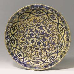 A MAMLUK BLUE AND WHITE POTTERY DISH PROBABLY DAMASCUS, SYRIA, 15TH CENTURY