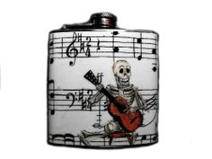 Dia De Los Muertos Stainless Steel Flask - 6oz. Day of the Dead - FD196 by DnA Creations. $16.00. This very unique flask is decorated with a durable image on the front only. The flask holds 6oz of your favorite liquor.