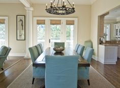 Neutral great room with aqua dining chairs | 212 Ocean Marsh Road | Kiawah Island Real Estate