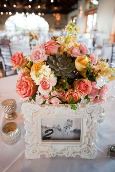 pink floral wedding reception centerpiece with pops of yellow