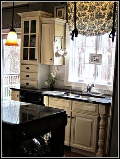 It's amazing. Just a touch here & there of Toile brings a smile to ones face & makes you so happy...love the idea for this kitchen area in the picture...Love the black & white together.