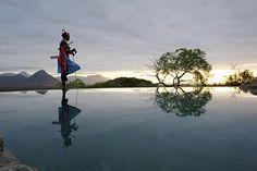 A Samburu warrior gazes out at the mountains in Kenya - Best Traveler Photographs for 2013