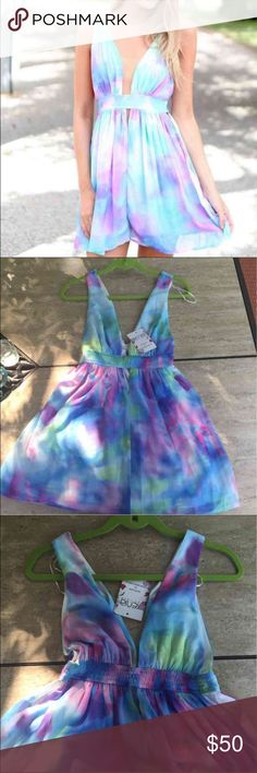 Xenia Tie Dye Dress Xenia tie dye swing plunge dress never worn NWT. Tag says size 12 but it's from Australia so it fits like a medium super beautiful dress Xenia Dresses Mini