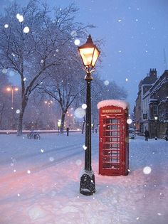Telephone booth plus falling snow