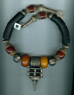 Antique Moroccan Berber perfume ring/hair ring necklace  Materials: silver, phenolic resin, resin, bakelite, acorn tops, sterling silver