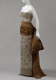 Evening Dress Balenciaga Autumn/Winter 1950–51 The dress is a strapless sheath with allover embroidery executed in a medallion pattern surro...