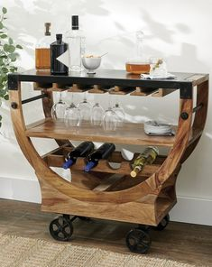 Surprise and delight your guests by rolling our exclusive bar cart right to the fun. When you're not entertaining, makes an inspired accent table in a dining room, entryway, or living space. Generous storage for glasses, bottles, and more that fits in just a small space. Round Glass Table Top, Wine Bottle Storage, Drum Table, Cushion Filling, Living Room Colors, Chair And Ottoman, Club Chairs, Bar Cart, Interior Decorating