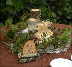 Rustic Centerpiece maybe with a little owl  and  a baby footprint instead of a number