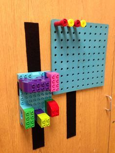 Position objects on a Velcro strip to work on shoulder strength, provide more sensory input, or just to get it at eye level. Aw, LOVE this idea