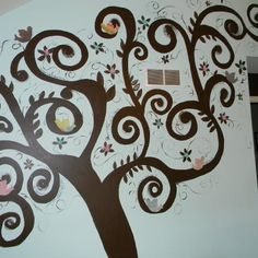 a tree with birds I painted on Maddy's wall