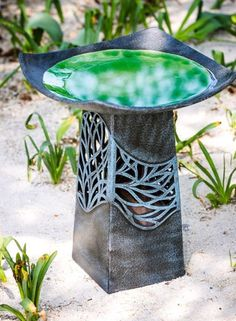 Rich glaze on this bird bath, ceramic pedestal lights up at night. Birds like it too with gentle, walk-in slope top!