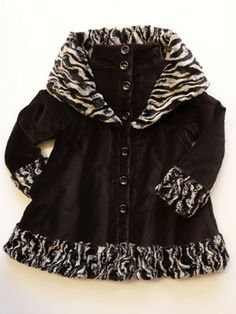 Eliane et Lena Girls Capa Coat Sizes 5-8 Sueded cotton velvet coat with faux fur trim.  Little girls and girls sizes 5-8.      Black winter swing coat with hood.     Faux fur trim at cuffs, hood, and hem.