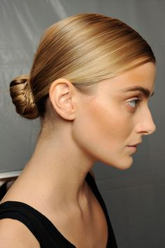 The ballerina bun has gone low this season. Take inspiration from the slick up-dos at Chloe S/S 2011 and pin a tight knot at the nape of your neck. -pin it by carden