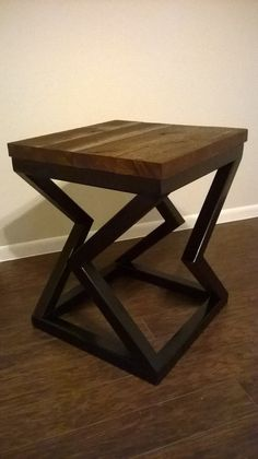 Hand made side table constructed from by Industrialirondesign