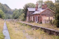 Britain's abandoned stations, tracks and trains: readers' pictures Abandoned Places In The Uk, Abandoned Cities, Abandoned Amusement Parks, Abandoned Houses, Derelict Buildings, Abandoned Property, Abandoned Train Station, Old Train Station, Train Stations