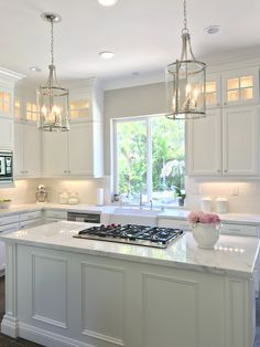 White kitchen with Danby marble and subway tile backsplash