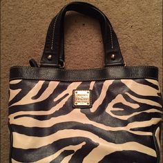 Dooney & Burke zebra-print purse Zebra print Dooney & Burke handbag in great condition! Used maybe 3 times. In the shape of a small tote. Black and white on the outside & red in the inside. Dooney & Bourke Bags Totes