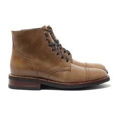 Thursday Boots' Natural Captain features: Natural Horween Leather, Goodyear Welt Construction, Full Glove Leather Interior Lining, Premium Flat Wax Laces, Cork-Bed Midsole, EVA Comfort Strip and Studded Rubber Outsoles.