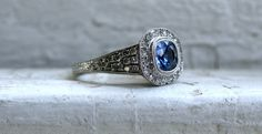 Stunning Halo Pave Diamond and Sapphire Tapered Engagement Ring.