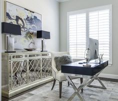 EJ Interiors gray cowhide rug mirrored credenza Charles Ray chair wall art gray walls lamps yellow accents chrome legs wood top x base desk Best Office, Cool Office Desk, Home Office Space, Home Office Design, Home Office Decor, House Design, Home Decor, Design Design, Office Chic