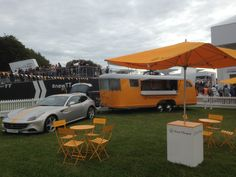 My Idea of #Glamping! Veuve Cliquot trailer towed by a Ferrari!