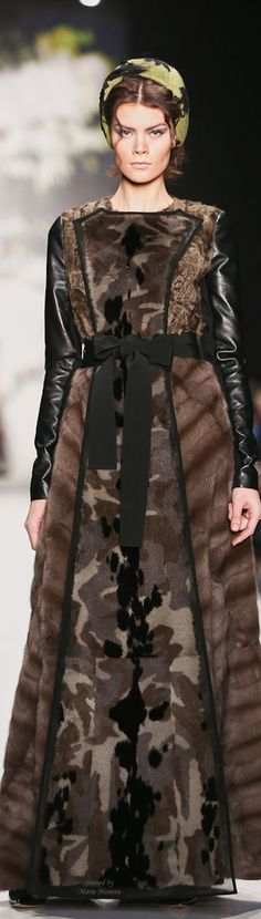 Igor Gulyaev RTW, 2015/2016--Artistic and unique.  Mink and leather coat with camouflage fur panels and a ribbon around the waist.  Interesting interplay of luxury, femininity, and military.