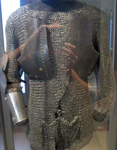 European riveted mail hauberk, open front design with overlapping lapels, Musee d'Armee, France.