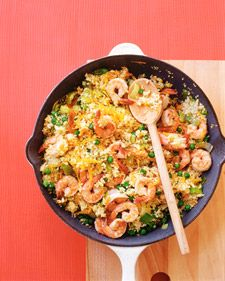 Shrimp Coucous 2 tablespoons olive oil  1 1/2 pounds medium shrimp, shelled and deveined  Coarse salt and ground pepper, for seasoning  1 teaspoon mustard seeds  2 leeks, sliced into 1/2-inch half-moons  2 carrots, shredded  5 cloves garlic, thinly sliced  1 cup couscous  1 cup frozen peas, thawed