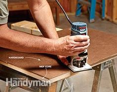 Uing a trim router to trim the router table tabletop.