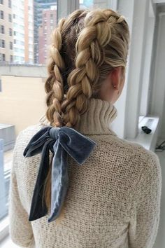 Statement Braids Make second-day, or even third-day, hair look absolutely dreamy with bold braids. Whether you pick a pretty fishtail braid or double Dutch braids, make it even cuter with a velvet bow. Box Braids Hairstyles, Winter Hairstyles, Trending Hairstyles, Pretty Hairstyles, Updo Hairstyle, Prom Hairstyles, Long Braided Hairstyles, Second Day Hairstyles, Hairstyles Videos