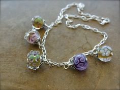 Sara Whitis jewelry.  Love this beautiful lampwork jewelry handmade by my cousin!