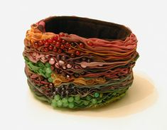 These are so cool looking...must find a tut! :) ~L ALYSON G. DESIGN . . . silk bangles.