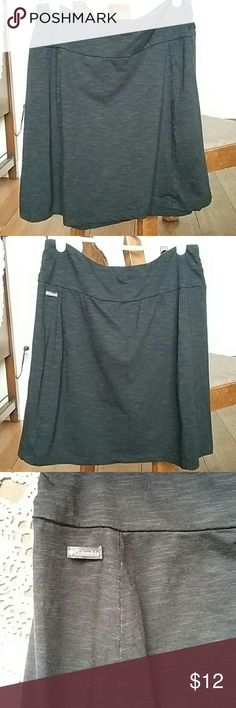 Columbia skirt Charcoal color. (Even though camera giving it an off color in pics 3,4&5) Very soft and so comfortable. Cute ruching at sides of waist band. No holes or stains. Great used condition. Columbia Skirts