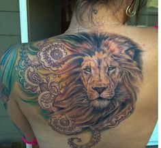 Absolutely love this tattoo, I would change up the outer design but I love the lion.