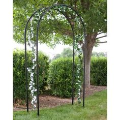our garden wedding arch looked like this but with a little more white ribblon sash and white flowers