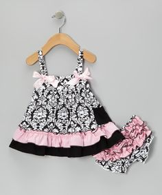 The fun print, perky bows and ruffles galore whip up whimsical perfection for the little one in this swing top, while the diaper cover delicately masks a derriere with ruffles and matching colors.Includes top and diaper cover97% cotton / 3% spandex exclusive of decorationHand wash; hang dry