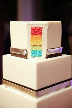 My favorite part might just be Ryan and Tyler's ridiculously awesome cake. On the outside, it fits the rest of the reception like a glove. It's square, streamlined, and super elegant with silver an...