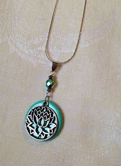 HANDMADE Polymer Clay blue teal aqua turquoise silver spring summer lotus flower charm necklace pendant . $25.00, via Etsy.