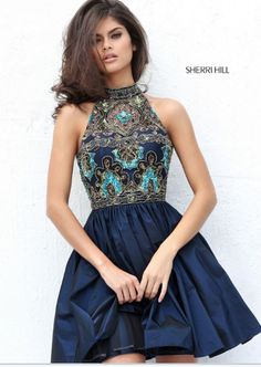 Sherri Hill has the most flattering and fashionable cocktail dresses to spice up your next party! Style 50706 available at WhatchamaCallit Boutique.